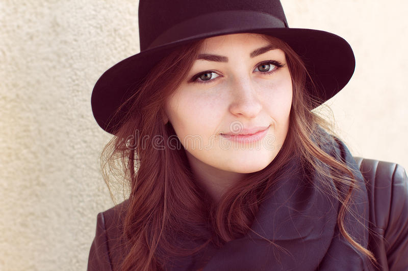 Portrait of a girl with green eyes and foxy hair in a black hat stock images