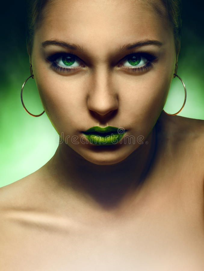 Portrait of girl with green eyes and lips stock images
