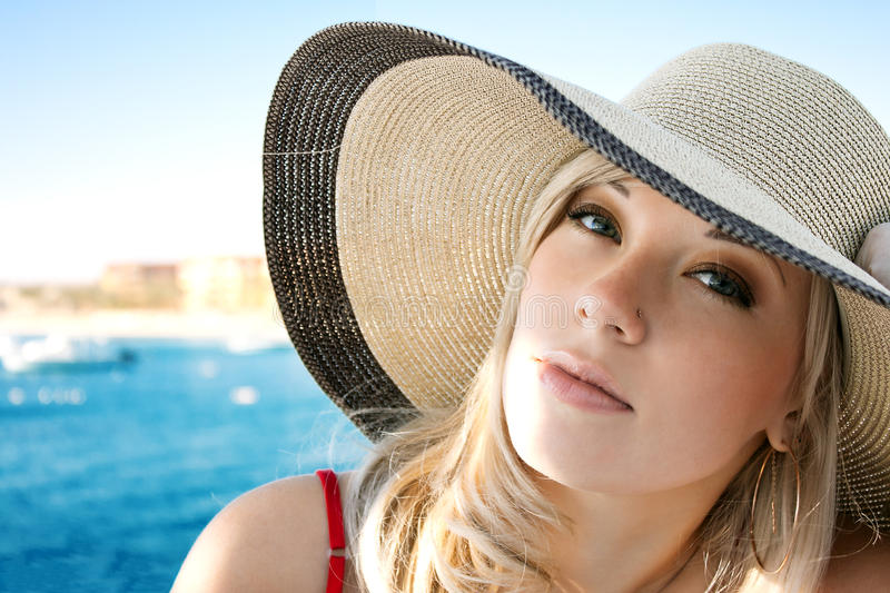 Portrait of the girl in a hat stock image