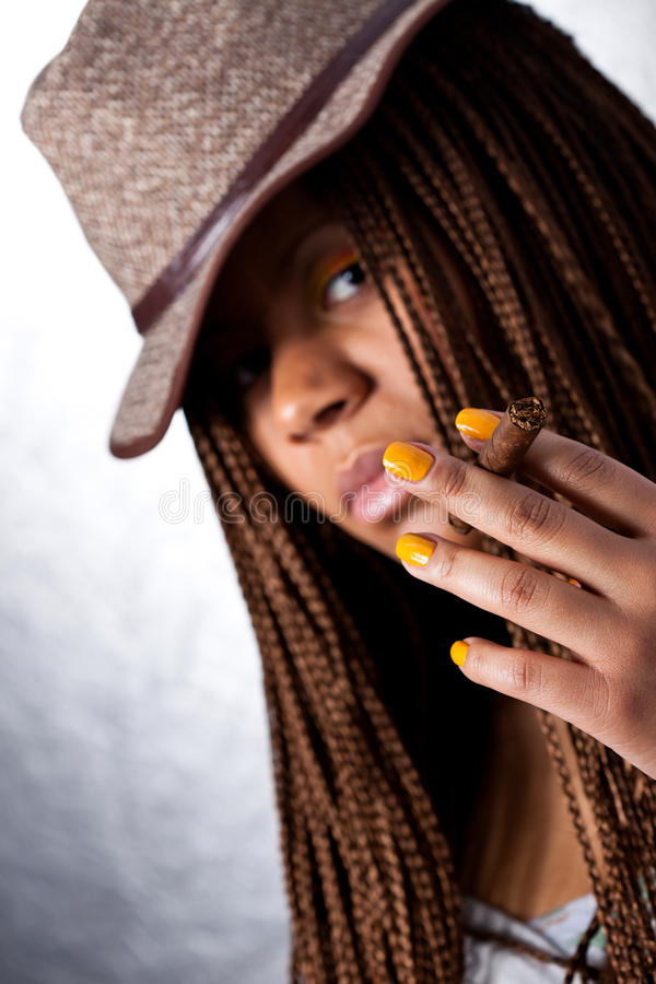 Girl with a cigar royalty free stock images