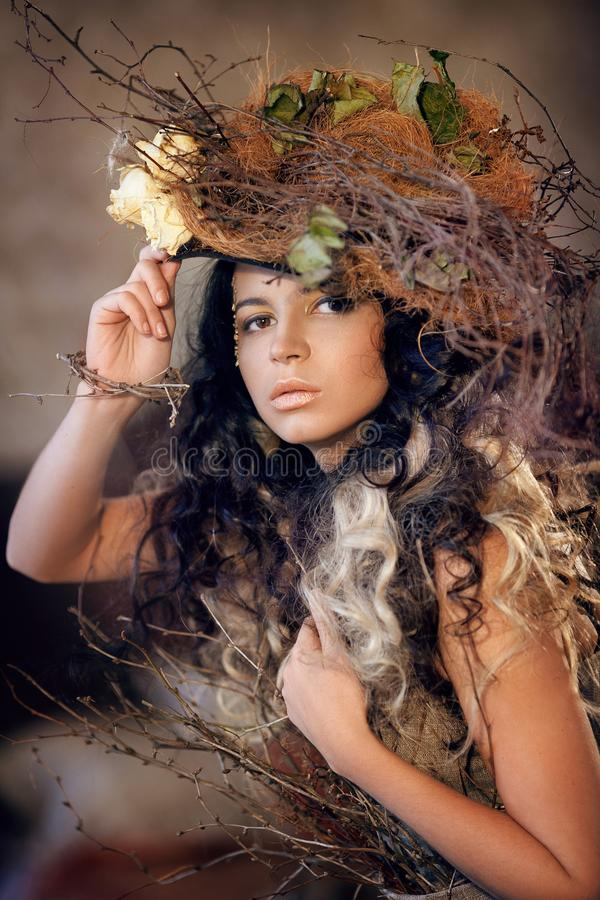 Portrait of girl in hat with dry flowers royalty free stock photography