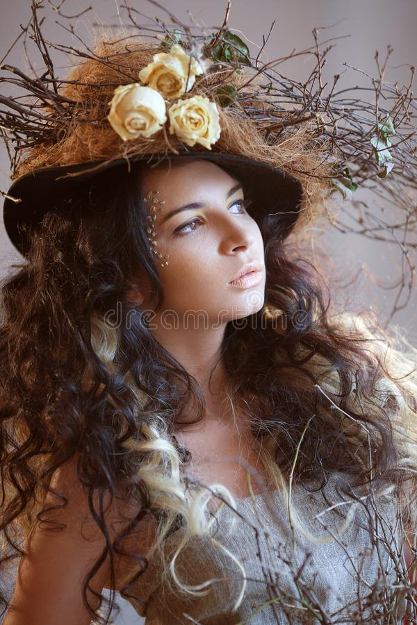 Portrait of girl in hat with dry flowers royalty free stock photo