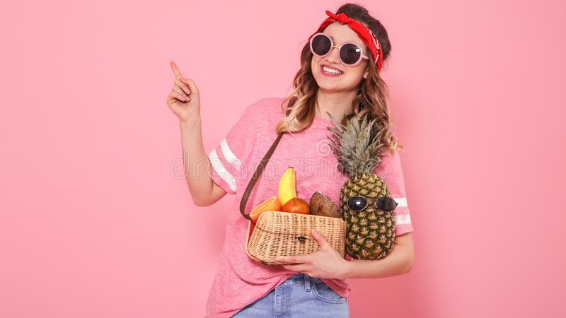 Portrait of a girl with healthy food, fruits, on a pink background stock photos