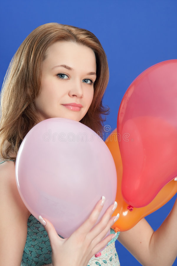Portrait of a girl holding color balloons stock image