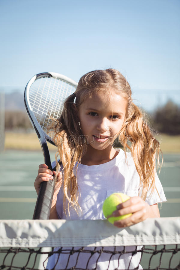 Portrait of girl holding racket and tennis ball royalty free stock images