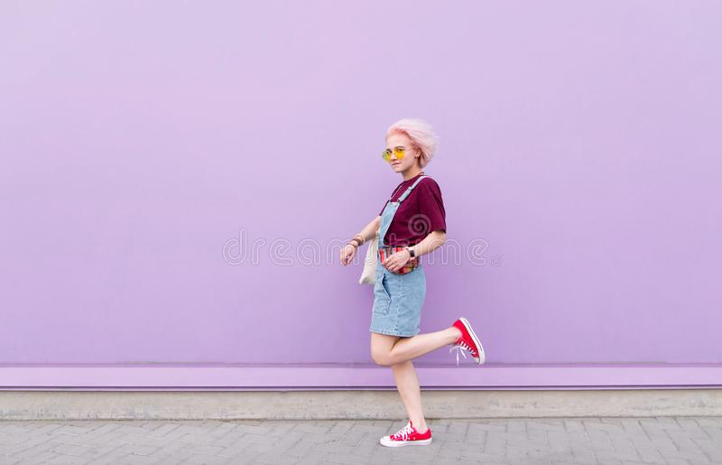 Portrait of a girl with an interesting look on a purple background stock image