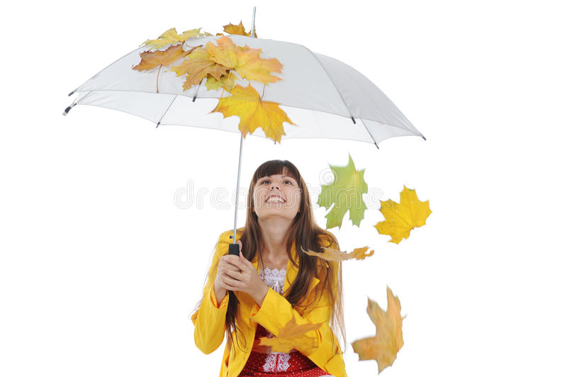 Portrait of the girl in a leather jacket. Beautiful smiling girl in in a yellow raincoat. Isolated on white background royalty free stock image