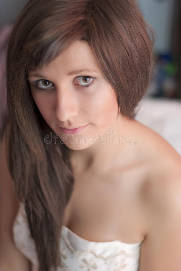 Portrait of a girl with long brown hair stock photos