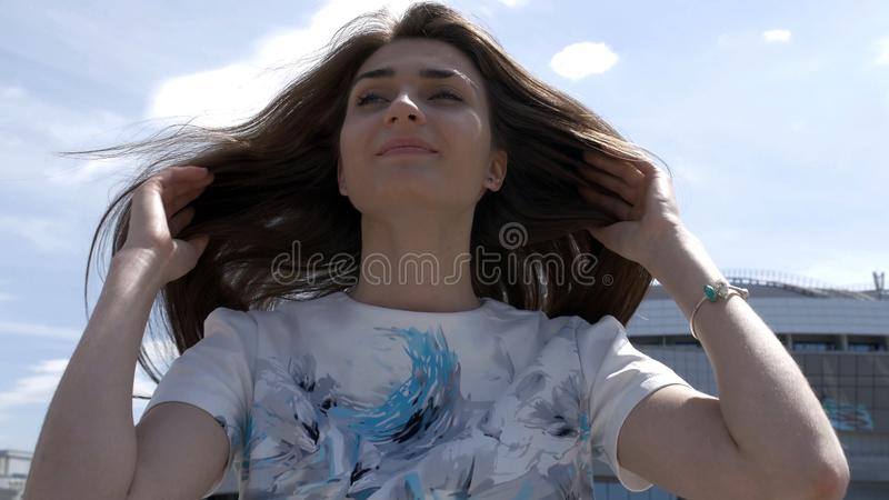 Portrait of a girl with long hair. touches hair. Have fun stock photos
