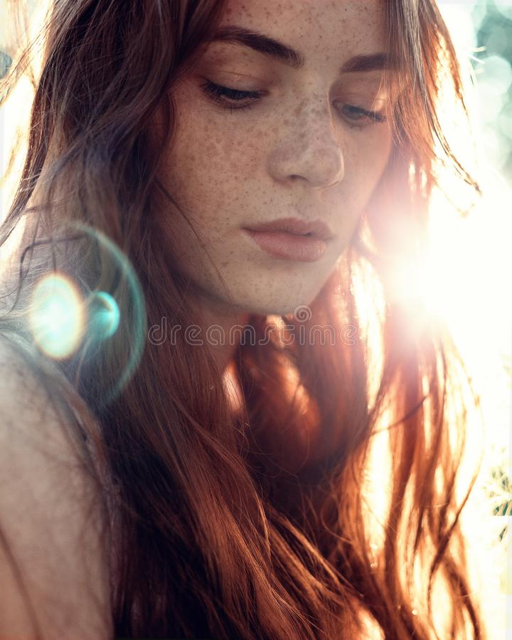 Portrait of a girl with red hair in the Sun stock photography