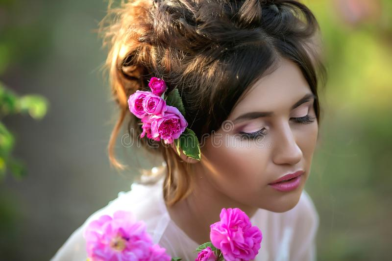 Portrait of a girl with make-up. With flowers in her hair. Beautiful face. Portrait of a girl with make-up. With flowers in her hair. Beautiful face royalty free stock photo