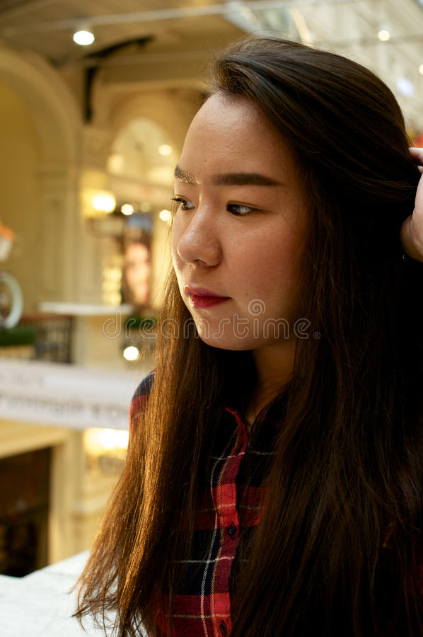 Portrait of a girl. Making hair and looking away royalty free stock photography