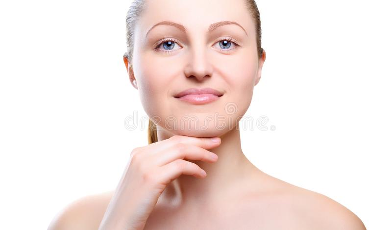 Portrait of girl with nude make-up with hands on chin. royalty free stock photo