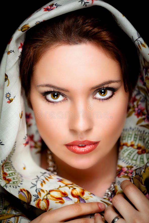 Portrait of girl with old russian shawl on head stock photography