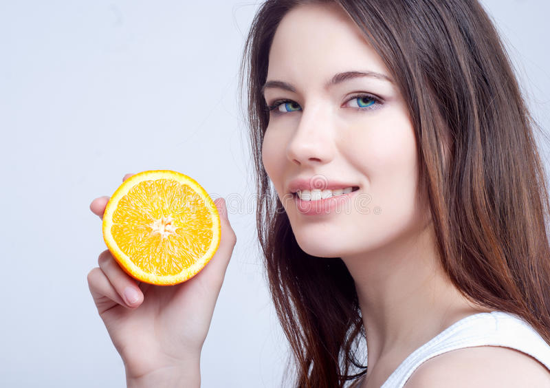 Download Portrait Of A Girl With An Orange Stock Image - Image of happy, fashion: 23958807