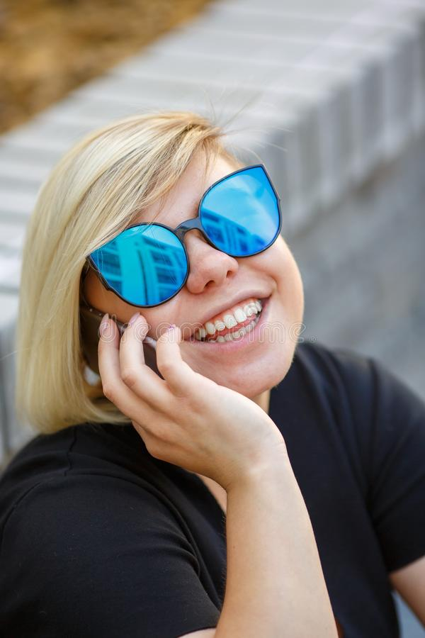 Portrait girl outdoors talking on the phone royalty free stock photo
