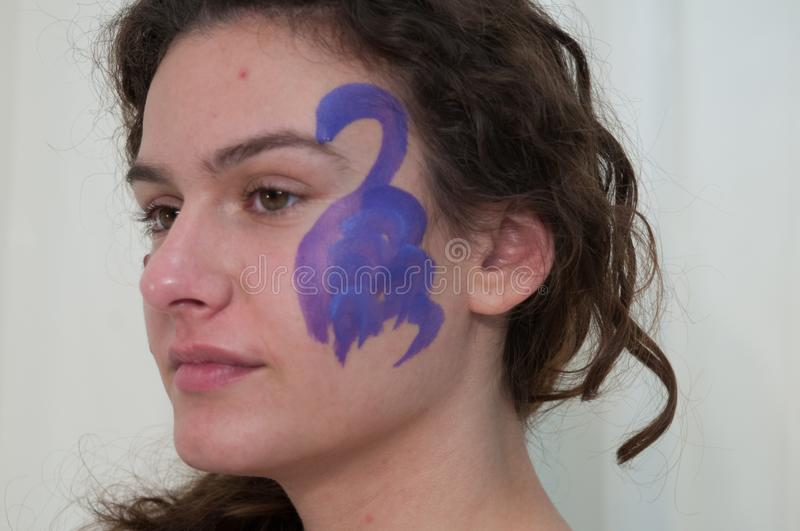 Body painting project, young woman colored on the body royalty free stock photos