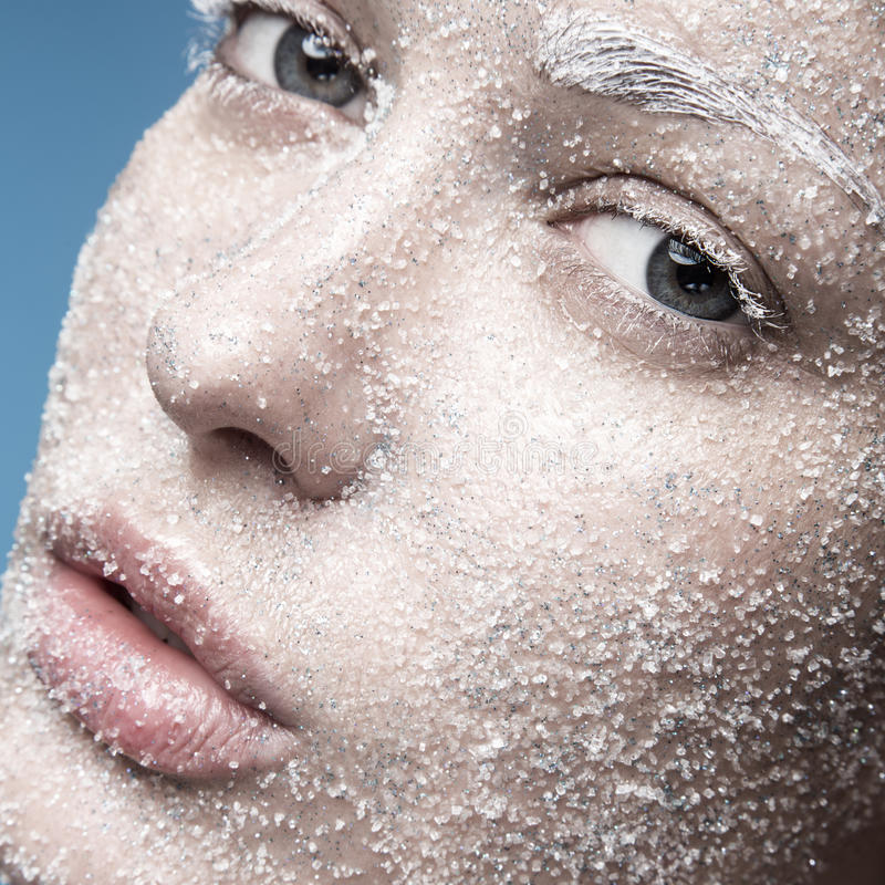 Portrait of girl with pale skin and sugar snow on royalty free stock photography