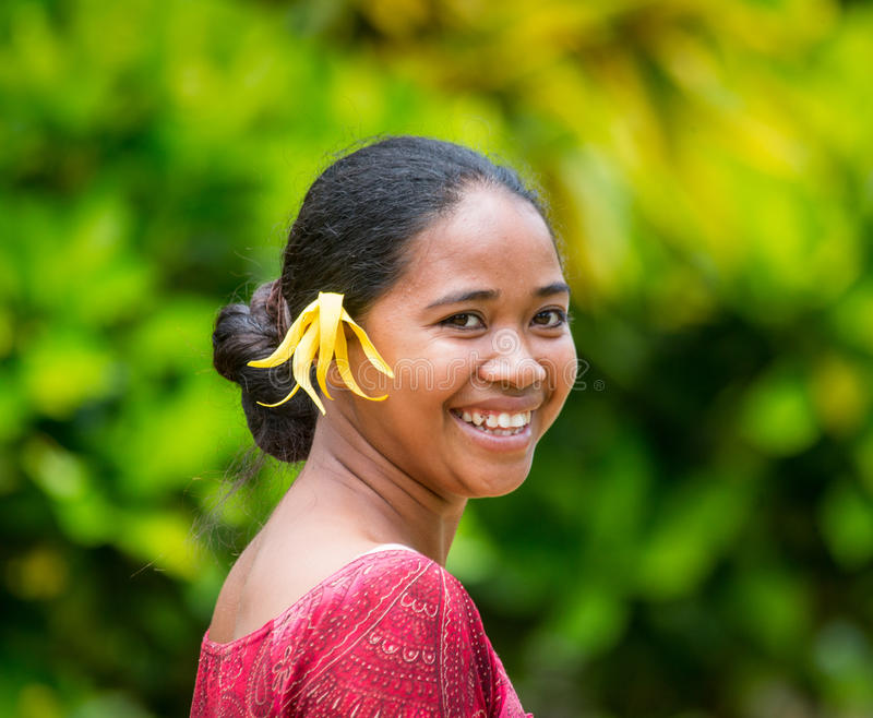 Portrait of a girl from the plantation Ylang Ylang. With Ylang Ylang flower in her hair. royalty free stock photo