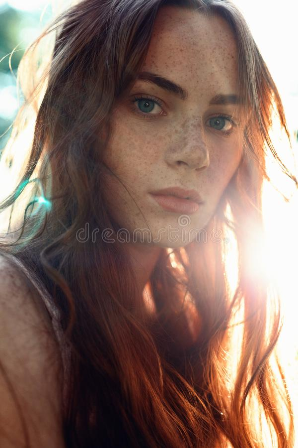 Portrait of a girl with red hair in the Sun royalty free stock image