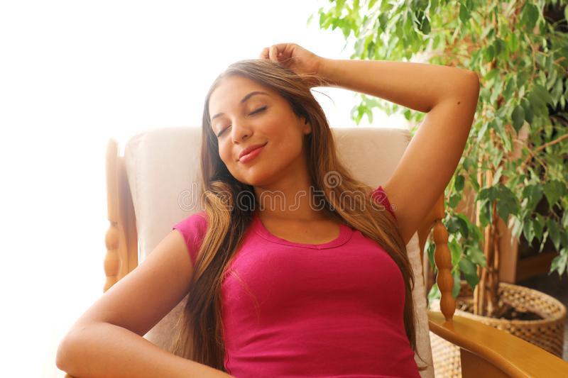 Portrait of a girl relaxing on a comfortable chair after work at home.  royalty free stock image
