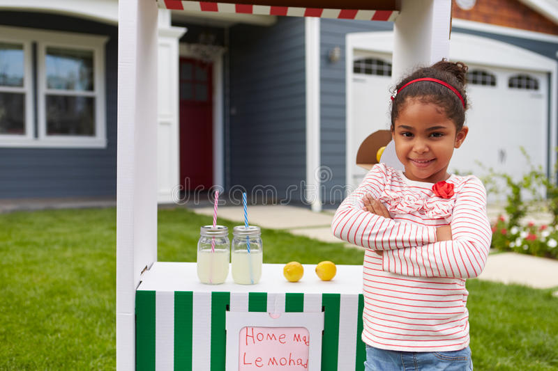 Portrait Of Girl Running Homemade Lemonade Stand stock image