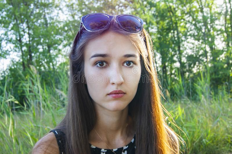 Portrait of girl`s emotions in the forest stock image