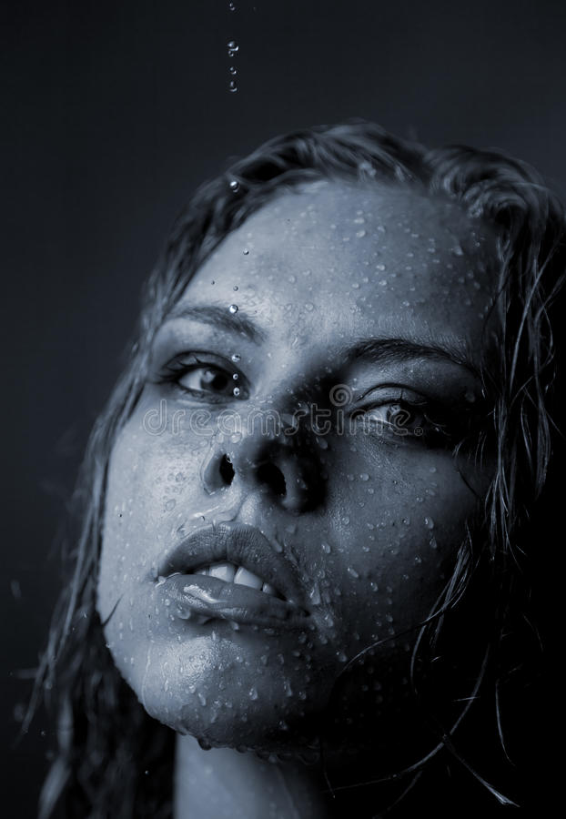 Portrait of a girl s face which water flows