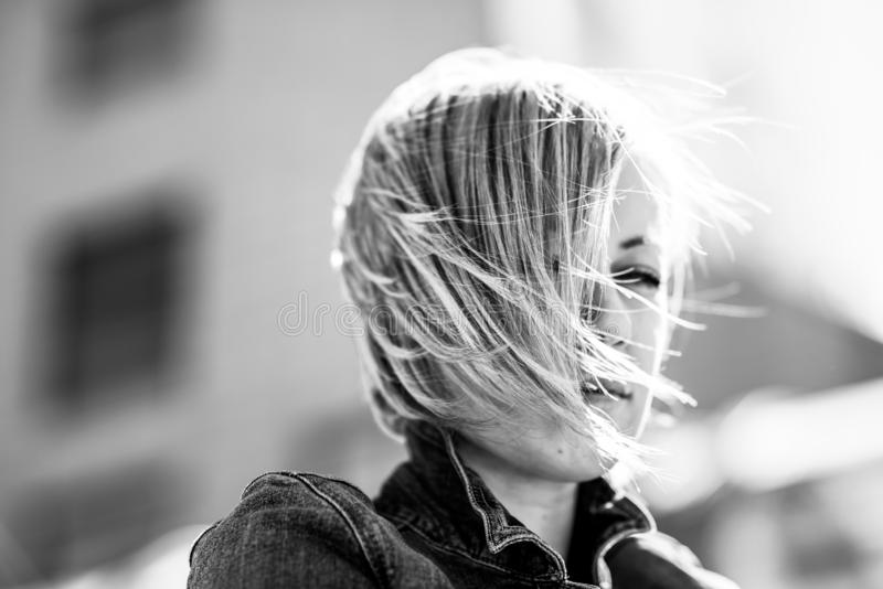 Portrait of a girl with short hair. Blonde in the city. Black and white photography stock photos