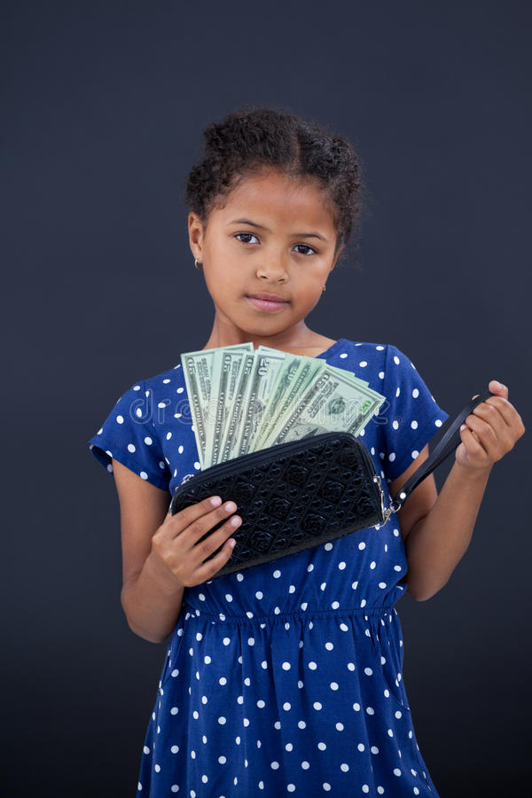 Portrait of girl showing currency in purse royalty free stock photography