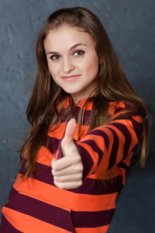Portrait of girl showing gesture All right! stock image