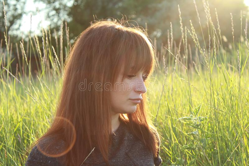 Woman portrait at sunset on the background of nature royalty free stock image