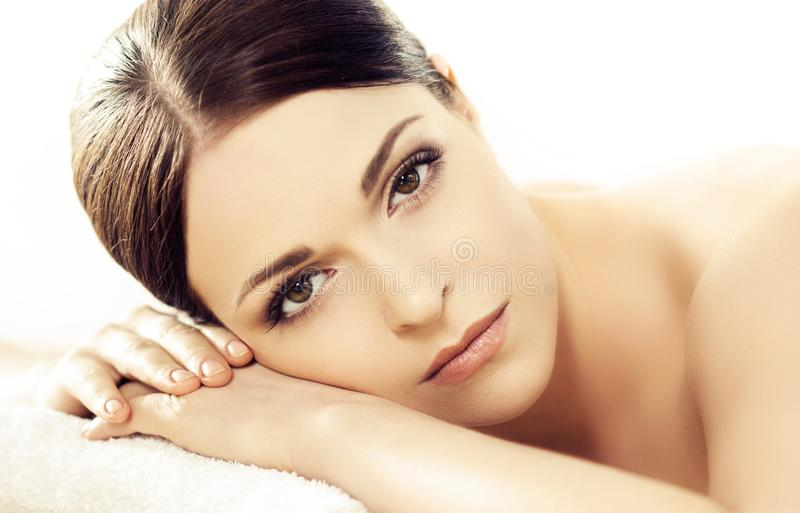 Portrait of a girl in spa. Massaging therapy procedure. Skin care and massage concept. stock image