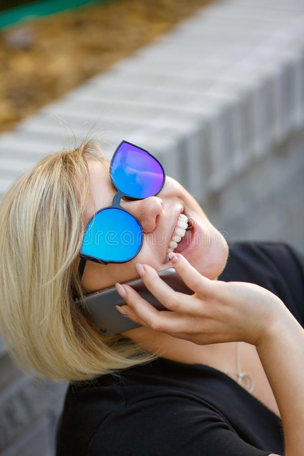 Portrait girl student outdoors talking on phone stock images