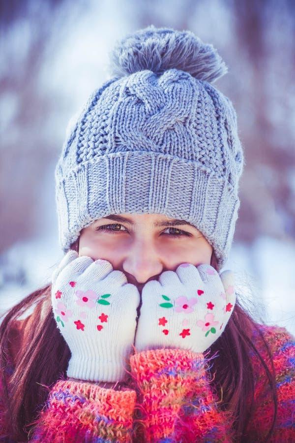 Portrait of girl in tea cozy hat stock photos