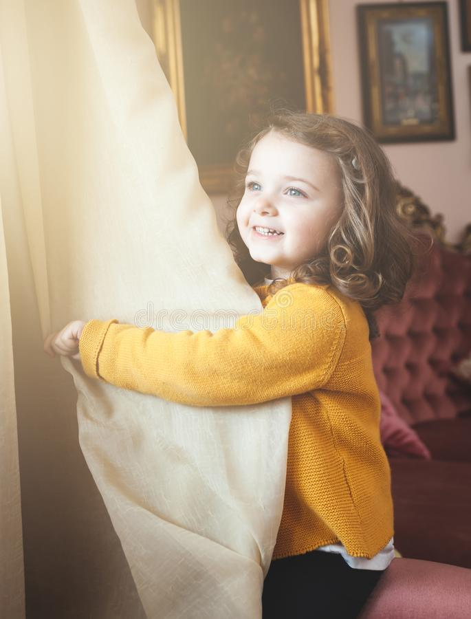 Girl toddler in a living room with baroque decor stock images