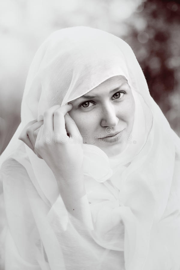 Portrait of a girl vested with a white cloth stock photography