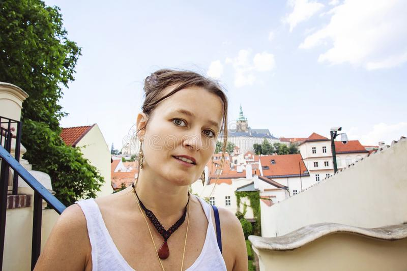 Portrait of young woman visiting Prague stock image
