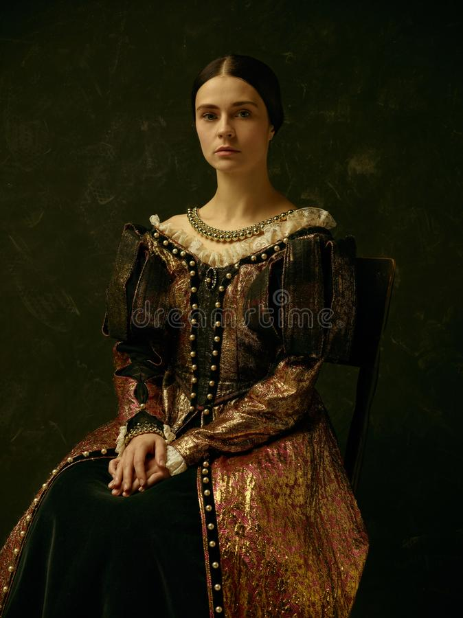 Portrait of a girl wearing a retro princess or countess dress royalty free stock images