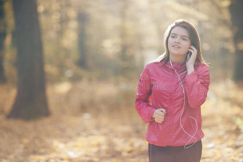 Portrait of a girl who trains and listens to music stock photo