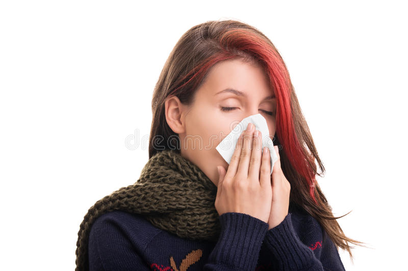 Portrait of a girl in winter clothes blowing her nose. Cold and flu season. Portrait of a girl in winter clothes blowing her nose, isolated on white background stock images