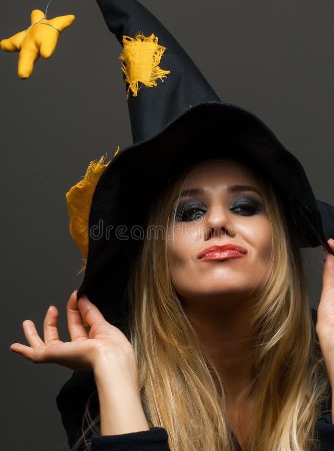 Portrait of a girl witch on halloween stock image