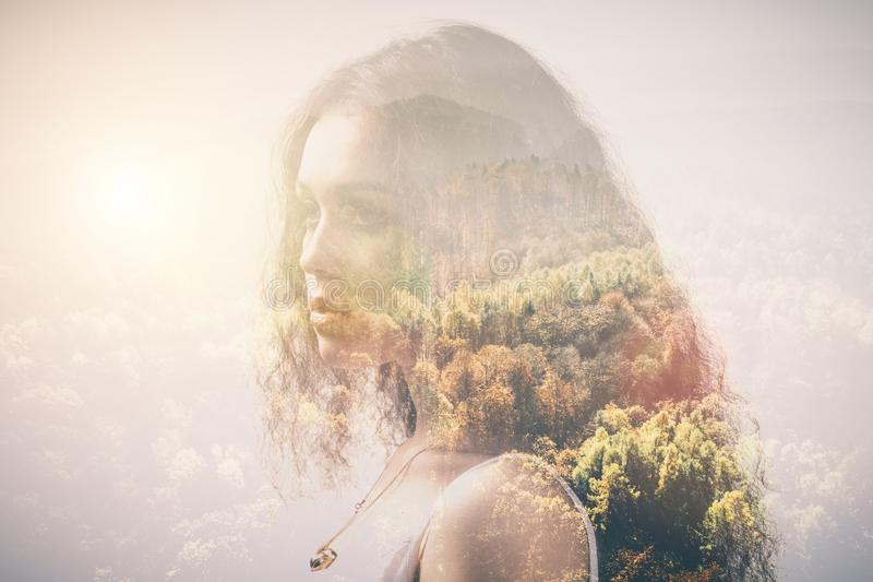 Portrait of a girl and woods, double exposure stock photos