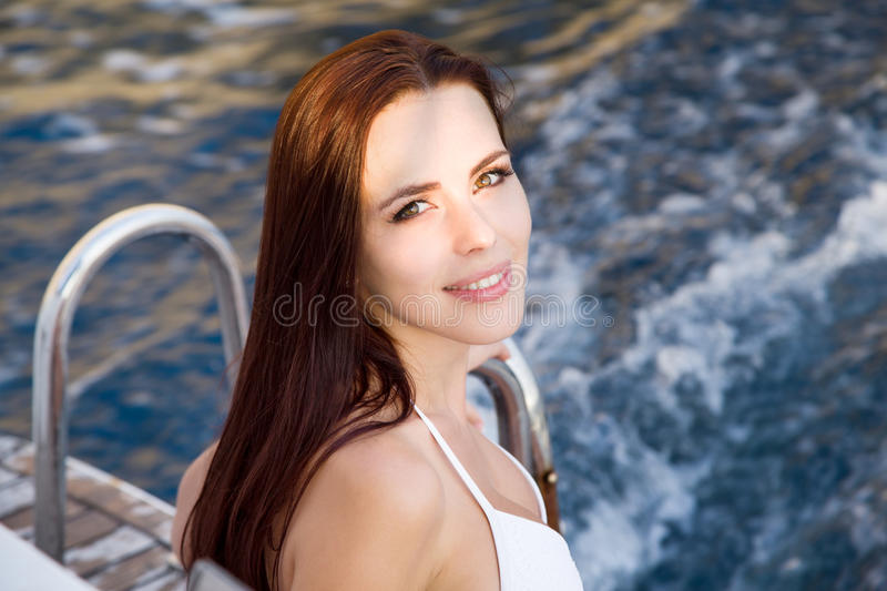 Portrait of a girl on a yacht royalty free stock photography