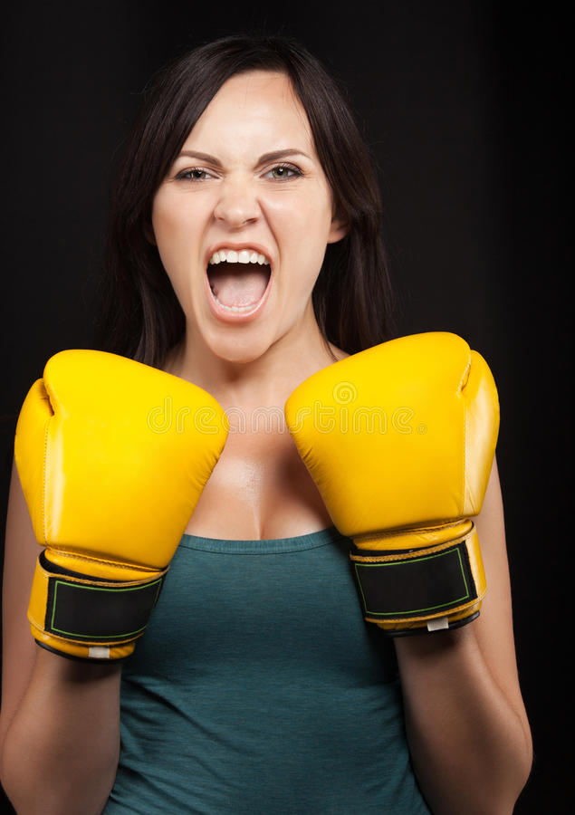 Download Portrait Of A Girl In Yellow Boxing Gloves Stock Image - Image: 26796803