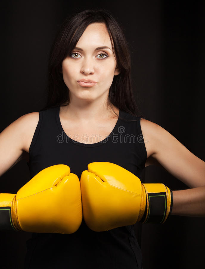 Download Portrait Of A Girl In Yellow Boxing Gloves Stock Photo - Image: 26796972