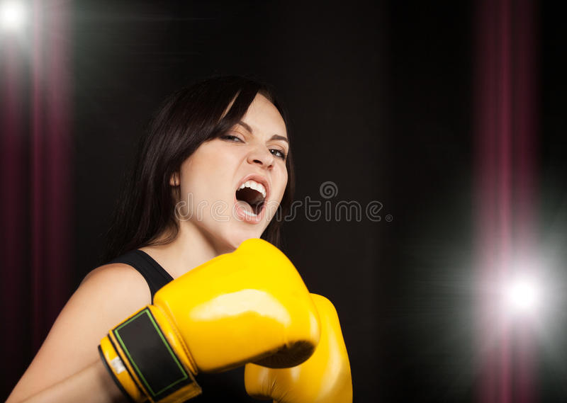 Download Portrait Of A Girl In Yellow Boxing Gloves Stock Image - Image: 26797011