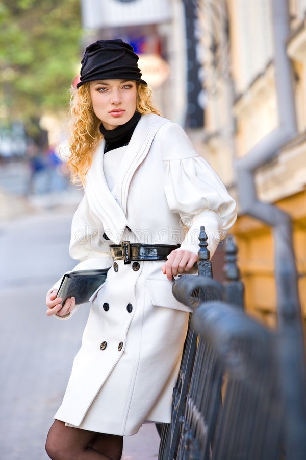 Portrait Girls In White Coats And Black Hat Stock Photo