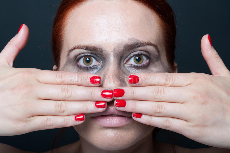 Portrait of glamorous woman with flowing mascara. Holding hands in front of her face royalty free stock photos