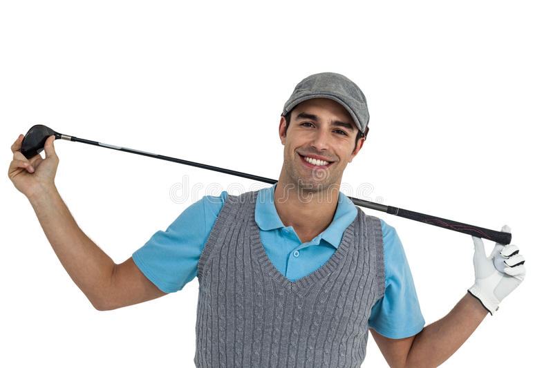 Portrait of golf player holding a golf club stock photography